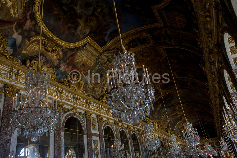 The 73 metre long Hall of the Mirrors in the King's Grand Apartment, Versaille, Paris. The Hall of Mirrors (Grande Galerie or Galerie des Glaces) is the central gallery of the Palace of Versailles and is renowned as being one of the most famous rooms in the world. The Palace of Versailles or simply Versailles, is a royal château in Versailles in the Île-de-France region of France. In French it is the Château de Versailles.