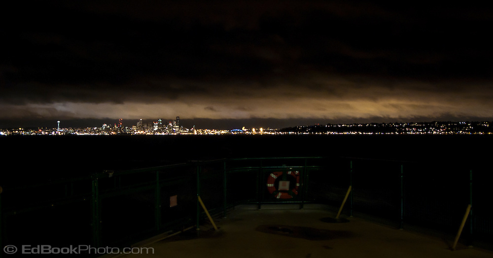 Seattle night skyline from the deck of a Washington State Ferry in Puget Sound, Washington, USA