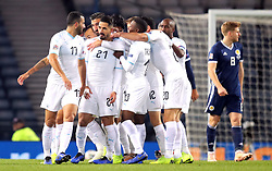 Israel's Beram Kayal (no. 21) celebrates scoring his side's first goal of the game with team-mates during the UEFA Nations League, Group C1 match at Hampden Park, Glasgow.