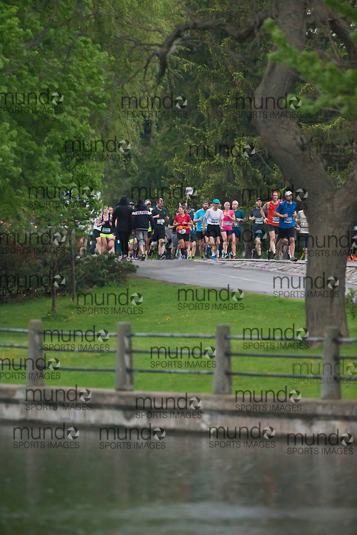 (Ottawa, Canada---25 May 2019) A pace bunny leads a group along the canal in the 2019 Run Ottawa 10K and Canadian 10K road racing championships. The race, held in Ottawa Canada, is an IAAF Gold Label 10K road race. Photograph copyright 2019 Sean Burges / Mundo Sport Images. For information on reproduction rights contact seanburges@mundosportimages.com.