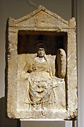 Marble votive relief with Cybele enthroned.  Post-2nd century AD.  The Goddess is represented in a small temple, wearing a sleeveless, girdled chiton, a himation and a high polos.  She holds a phiale in the right hand and a drum in the left.  Visible on her knees are traces of a lion.  The lion and the drum, which was played during rites in Cybele's honour, were the attributes of the Great Mother Goddess of Asia Minor.  Small temples of this kind, which perhaps denote the shallow caves in which statues of her were placed, are identified in sanctuaries of Cybele and other deities after the Late Classical period, in private houses and in cemeteries.