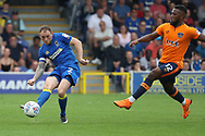 AFC Wimbledon defender Barry Fuller (2) passing the ball during the EFL Sky Bet League 1 match between AFC Wimbledon and Oldham Athletic at the Cherry Red Records Stadium, Kingston, England on 21 April 2018. Picture by Matthew Redman.