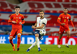 LONDON, ENGLAND - Thursday, October 8, 2020: Wales' Dylan Levitt (L) and England's Harry Winks during the International Friendly match between England and Wales at Wembley Stadium. The game was played behind closed doors due to the UK Government's social distancing laws prohibiting supporters from attending events inside stadiums as a result of the Coronavirus Pandemic. England won 3-0. (Pic by David Rawcliffe/Propaganda)