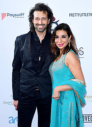Armand Beasley (left) and Shobna Gulati attending the 8th Annual Asian Awards held at the Hilton Hotel, Park Lane, London.