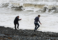 © Licensed to London News Pictures. 19/09/2018. Aberystwyth, UK. People play near the waters edge in Aberystwyth as Storm Ali, the first named storm of the UK winter season, gathers strength, promising very high winds and heavy rain for north western parts of the UK today. Photo credit: Keith Morris/LNP