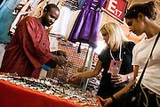 Visitors look at jewelry at the 22nd Salon International de l'Artisanat de Ouagadougou (SIAO) in Ouagadougou, Burkina Faso on Sunday November 2, 2008.