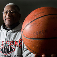 (SPORTS) Neptune 2/10/2006  Henry Moore is the former Neptune boys basketball coach that won the 1981 state championship with a record of 29-0.  Henry holds a basketball signed by team.  Michael J. Treola Staff Photographer....MJT