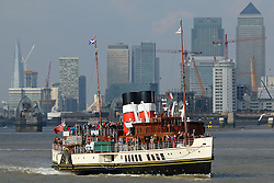 © Licensed to London News Pictures. 01/10/2015. Historic Scottish paddlesteamer Waverley pictured in sunshine on the Thames in London with Canary Wharf and the Thames Barrier behind. October has got started with beautiful sunshine and warm temperatures across London. Credit : Rob Powell/LNP