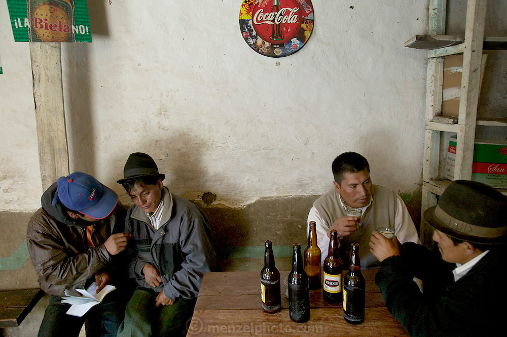Taking advantage of their visit to town, men (and a few women) throng the taverns, to drink Andean beer. Hungry Planet: What the World Eats (p. 111).