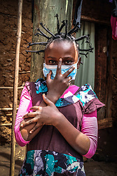 May 2, 2020, Nairobi, Kenya: 12 year old Martha Apisa is seen using her hair style braids to create awareness and sensation about the Corona Virus. (Credit Image: © Donwilson Odhiambo/ZUMA Wire)