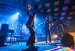 A wide angle shot from the photo pit of Nick Cave and violinist-cum-flautist Warren Ellis, of Nick Cave and the Bad Seeds, on stage tonight at The Barrowlands, Glasgow, Scotland.<br /> ©Michael Schofield.