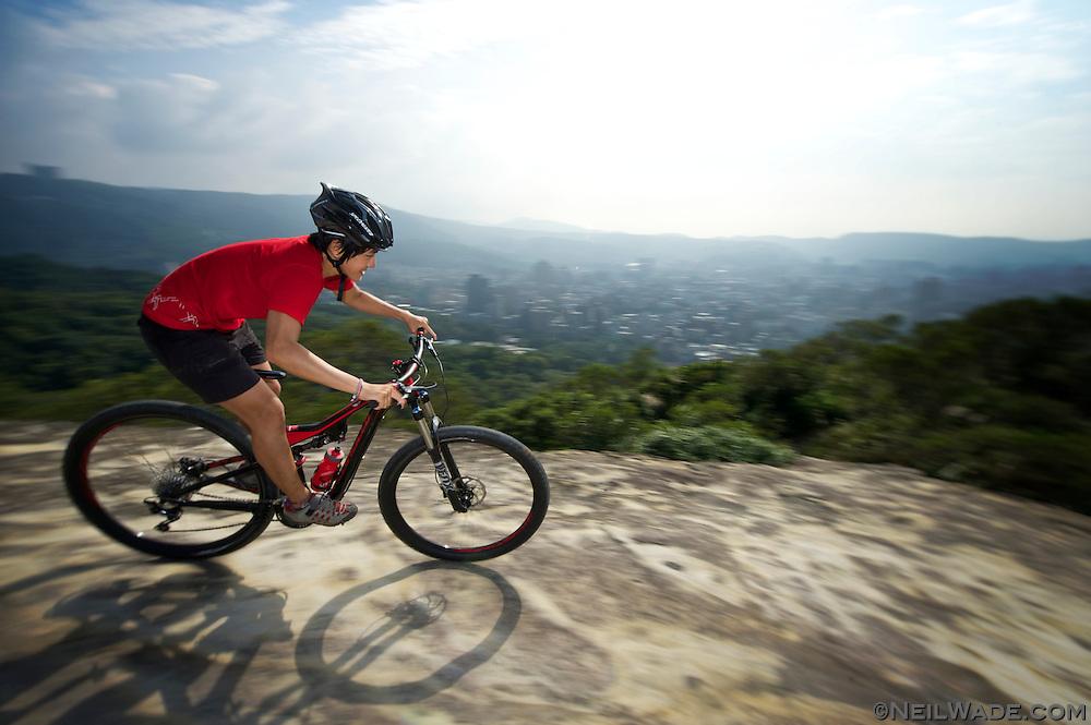 A mountain biker descends a trail above Taipei, Taiwan.