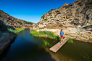 Hiker in Water Canyon, Santa Rosa Island, Channel Islands National Park, California USA