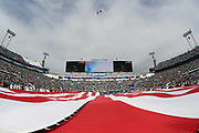 """Members of the U.S. Military wave a giant American flag in celebration of """"Salute to Service"""" as jets fly over EverBank Field stadium during the playing of the National Anthem before the Jacksonville Jaguars 2016 NFL week 10 regular season football game against the Houston Texans on Sunday, Nov. 13, 2016 in Jacksonville, Fla. The Texans won the game 24-21. (©Paul Anthony Spinelli)"""