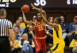 Feb 24, 2018; Morgantown, WV, USA; Iowa State Cyclones forward Zoran Talley Jr. (23) is pressured by West Virginia Mountaineers forward Lamont West (15) during the second half at WVU Coliseum. Mandatory Credit: Ben Queen-USA TODAY Sports