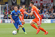 AFC Wimbledon midfielder Dean Parrett (18) battles for possession with Shrewsbury Town defender James Bolton (13) during the EFL Sky Bet League 1 match between AFC Wimbledon and Shrewsbury Town at the Cherry Red Records Stadium, Kingston, England on 12 August 2017. Photo by Matthew Redman.