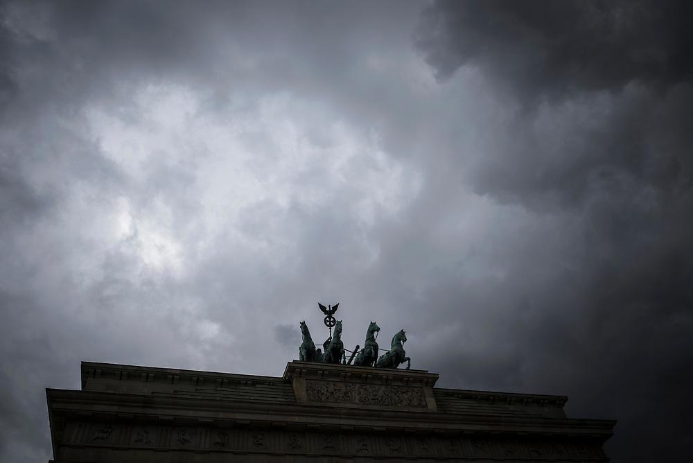 Berlin, Germany - September 5, 2015: Dark clouds over the Brandenburg Gate in Berlin, Germany