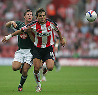 Photo: Lee Earle.<br /> Southampton v Plymouth Argyle. Coca Cola Championship. 16/09/2006. Plymouth's David Norris (L) battles with Inigo Idiakez.