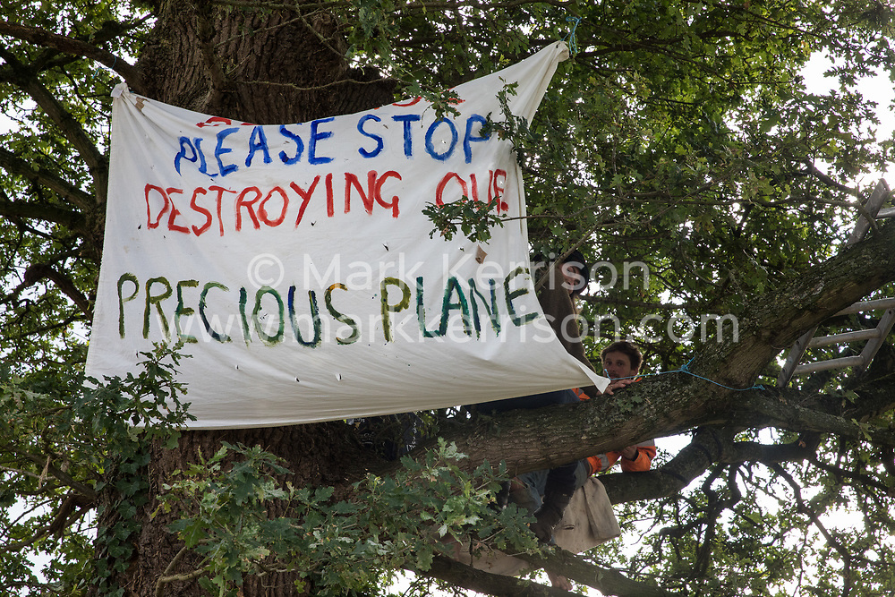 Anti-HS2 activists occupy a mature oak tree alongside the Fosse Way in order to try to prevent or delay its felling in connection with the HS2 high-speed rail link on 24th August 2020 in Offchurch, United Kingdom. The controversial HS2 infrastructure project is currently expected to cost £106bn and will destroy or significantly impact many irreplaceable natural habitats, including 108 ancient woodlands.