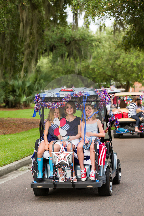 Golf cart decorated with bunting and American flags during the Daniel Island Independence Day parade July 3, 2015 in Charleston, South Carolina.