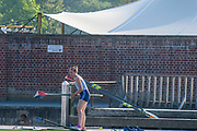 Henley-On-Thames, Berkshire, UK., Wednesday,  12/08/2020,  Athlete, Women's single scull, going afloat from the Leander Club pontoon, for a training session, how to attach the scull, into the waterside Gate/Oar Lock, of the single sculling boat,  [Mandatory Credit © Peter Spurrier/Intersport Images], , Training during, the  coronavirus (COVID-19), pandemic,