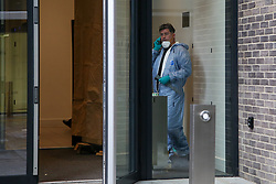 © Licensed to London News Pictures. 23/11/2019. London, UK. A forensic officer is seen inside Blakeney Tower on Buckle Street in Tower Hamlets, East London following a fatal stabbing.<br /> Police were called to a residential address in Blakeney Tower on Buckle Street, Tower Hamlets in East London at 08.48hrs this morning following reports of a stabbing. A male, in his 20s, was found with stab injuries. Despite the efforts of emergency services, he was pronounced dead at the scene. Three other males with stab injuries were treated at the scene by paramedics before being taken to hospital. Photo credit: Dinendra Haria/LNP