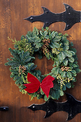 North America, USA, Washington, Leavenworth. Christmas wreath on wood door