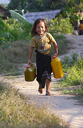 Unnamed girl (no age provided) fills her buckets with drinking water from a gravity feed tap system at Houykoun village and carries them back slung across her shoulders in the traditional way. The water is coming out brown and obviously polluted. Pha Oudom District, Bokeo Province, Lao PDR