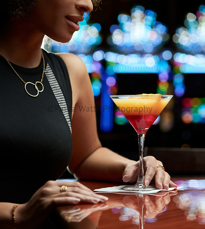 Female at bar with cocktail at casino in California
