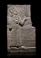 Hittite relief sculpted orthostat stone panel of Long Wall Basalt, Karkamıs, (Kargamıs), Carchemish (Karkemish), 900-700 B.C. Anatolian Civilisations Museum, Ankara, Turkey<br /> <br /> Goddess Kubaba. Goddess is depicted from the profile. She holds a pomegranate in her hands on her chest. She carries a one-horned headdress on her head. Her braided hair hangs down to her shoulder . <br /> <br /> On a black background. .<br />  <br /> If you prefer to buy from our ALAMY STOCK LIBRARY page at https://www.alamy.com/portfolio/paul-williams-funkystock/hittite-art-antiquities.html  - Type  Karkamıs in LOWER SEARCH WITHIN GALLERY box. Refine search by adding background colour, place, museum etc.<br /> <br /> Visit our HITTITE PHOTO COLLECTIONS for more photos to download or buy as wall art prints https://funkystock.photoshelter.com/gallery-collection/The-Hittites-Art-Artefacts-Antiquities-Historic-Sites-Pictures-Images-of/C0000NUBSMhSc3Oo