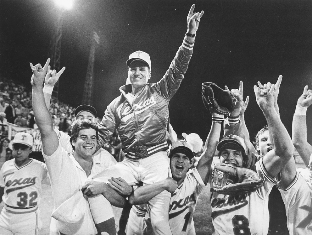 ©1983  Texas coach Cliff Gustafson is carried off the field after UT won the College World Series in Omaha.