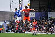 Portsmouth Forward, Oliver Hawkins (9) wins a header against Northampton Town Defender, Ash Taylor (6) during the EFL Sky Bet League 1 match between Portsmouth and Northampton Town at Fratton Park, Portsmouth, England on 30 December 2017. Photo by Adam Rivers.