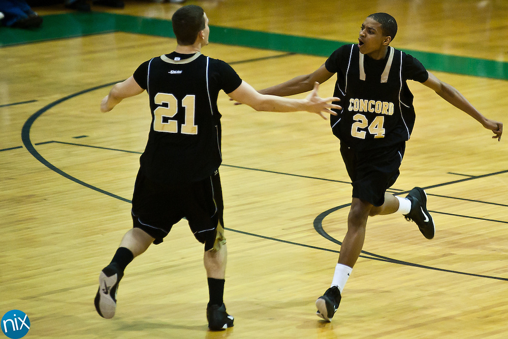 Concord's Darren Black and Will Vanderburg celebrate a Concord point against Kannapolis Saturday night at A.L .Brown High School. Concord won the cross-town rivalry 80-73. (Photo by James Nix)