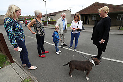 Labour leader Jeremy Corbyn speaks to locals whilst on a visit to Carol Woolford's (second left) home in Reading West, to speak to her about fuel poverty.
