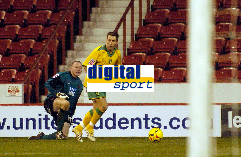 Photo: Jed Wee.<br />Sheffield United v Norwich City. Coca Cola Championship.<br />26/12/2005.<br />Norwich's Darren Huckerby (R) leaves Sheffield United goalkeeper Paddy Kenny stranded on the touchline in the build up to their third goal.