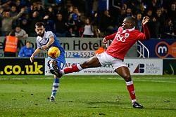 Jack Payne of Peterborough United clears past Kieran Agard of Bristol City - Photo mandatory by-line: Rogan Thomson/JMP - 07966 386802 - 28/11/2014 - SPORT - FOOTBALL - Peterborough, England - ABAX Stadium - Peterborough United v Bristol City - Sky Bet League 1.