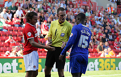 Referee Darren Deadman asks Charlton Athletic's Lawrie Wilson and Leicester City's Jeffrey Schlupp to shake hands  - Photo mandatory by-line: Robin White/JMP - Tel: Mobile: 07966 386802 31/08/2013 - SPORT - FOOTBALL - The Valley - Charlton - Charlton Athletic V Leicester City - Sky Bet Championship