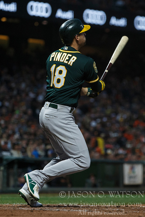 SAN FRANCISCO, CA - JULY 13: Chad Pinder #18 of the Oakland Athletics hits a home run against the San Francisco Giants during the fifth inning at AT&T Park on July 13, 2018 in San Francisco, California. The San Francisco Giants defeated the Oakland Athletics 7-1. (Photo by Jason O. Watson/Getty Images) *** Local Caption *** Chad Pinder