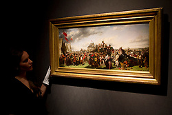 © Licensed to London News Pictures. 08/12/2011. London, UK. 'Derby Day' the first working of a masterpiece by William Powell Frith, recently discovered in an American beach house where it had been hanging for 50 years (est £300,000-500,000) on display at Christie's where it will be auctioned off on 15th December, the auction is expected to realise in excess of £4.5million.  Photo credit : James Gourley/LNP
