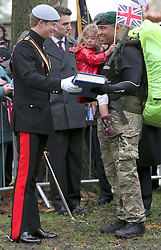 © under license to London News Pictures.  09/11/10 ..Prince Harry hands a Book of Remembrance to Royal Marines Commando Lance Corporal Ram Patten with Melanie Patten, aged four, at the the start of The Royal British Legion March For Honour, at Lydiard Park, Wiltshire. The service personnel will march to London, ..to commemorate servicemen and women who have fallen in Iraq and Afghanistan.