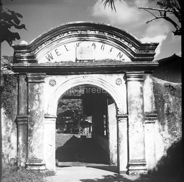 Entry arch of the Dutch colonial Welvaren nutmeg plantation on Pulau Ai, Maluku, Indonesia