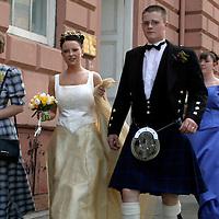 Europe, United Kingdom, Great Britain, Scotland, Edinburgh. A newly married Scottish bride and groom.