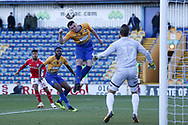 Matt Preston of Mansfield Town (4) heads clear the danger during the The FA Cup match between Mansfield Town and Charlton Athletic at the One Call Stadium, Mansfield, England on 11 November 2018.