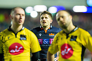 Henry Pyrgos (#21) of Edinburgh Rugby watches on as the officials check with the television match official during the 1872 Cup second leg Guinness Pro14 2019_20 match between Edinburgh Rugby and Glasgow Warriors at BT Murrayfield Stadium, Edinburgh, Scotland on 28 December 2019.