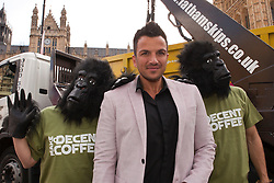 © under license to London News Pictures. 25/06/12..Peter Andre launches  the make decent coffee revolution outside the Houses of Parliament encouraging members of the public to throw away instant coffee in exchange for samples of  'decent coffee'...ALEX CHRISTOFIDES/LNP