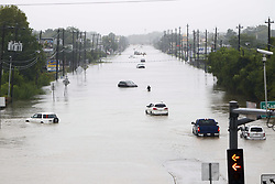 (170827) -- HOUSTON, Aug. 27, 2017 (Xinhua) -- Vehicles are stranded in flood in great Houston area, Texas, the United States, Aug. 27, 2017. Widespread and worsening flood conditions prompted the closure of nearly every major road in Houston as the outer bands of Hurricane Harvey swept through the Houston area over the weekend. Latest news reports said the storm death toll has climbed to at least 5. (Xinhua/Song Qiong) (Photo by Xinhua/Sipa USA)