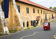 Motorised rickshaw by fort walls inside the historic town of Galle, Sri Lanka, Asia