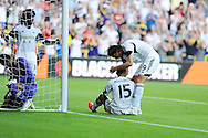 Swansea city's Wayne Routledge (15) celebrates with Michu after he scores his sides 3rd goal. UEFA Europa league, play off round, 1st leg match, Swansea city v FC Petrolul Ploiesti at the Liberty stadium in Swansea on Thursday 22nd August 2013. pic by Andrew Orchard , Andrew Orchard sports photography,
