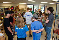 """Sandor Ganache leads his freshman advisory group in """"The Big Wind Blows"""" activity for students to learn about one another during Freshman Jump Start at GHS Wednesday morning.  (Karen Bobotas/for the Laconia Daily Sun)"""