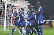 Ade Azeez of AFC Wimbledon celebrates with team during the Sky Bet League 2 match between Cambridge United and AFC Wimbledon at the R Costings Abbey Stadium, Cambridge, England on 2 January 2016. Photo by Stuart Butcher.